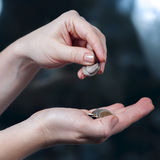 Woman's hands holding coins, russian rubles Royalty Free Stock Photography