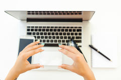 Woman`s hands holding a credit card and using laptop for online shopping Royalty Free Stock Photo