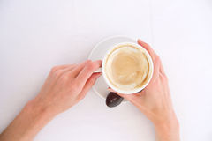 Woman's hands holding cup of cappuccino Stock Images