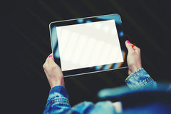 Woman's hands holding digital tablet with blank template copy space screen for your information or content Stock Image