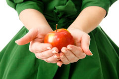 Woman's hands holding a fresh apple Royalty Free Stock Photo