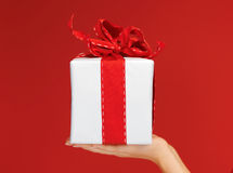 Woman's hands holding a gift box Royalty Free Stock Images