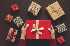 Woman`s hands holding gift box. Present boxes background royalty free stock images