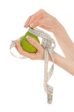 Woman's hands holding green pear Stock Photo