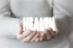 Woman& x27;s hands holding HEALTH Royalty Free Stock Images
