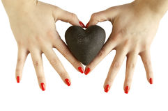 Woman's hands holding heart Stock Photo