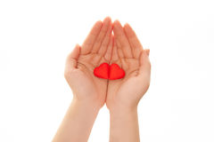 Woman's hands holding heart-shaped cookies. Woman's hands holding heart-shaped cookies isolated on white Royalty Free Stock Photos