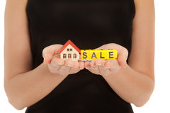 Woman's hands holding house and keys Royalty Free Stock Image