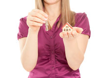 Woman's hands holding house and keys Royalty Free Stock Images