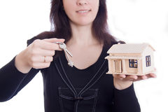 Woman's hands holding house and keys Royalty Free Stock Photos