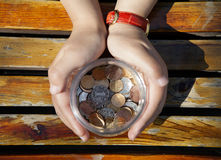 Woman's hands holding a jar with coins Royalty Free Stock Photos