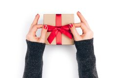 Woman`s hands with gift box Royalty Free Stock Image