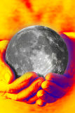 Woman`s hands holding the moon royalty free stock photos