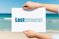 Woman's Hands Holding Placard With Last Minute Sign On Beach Royalty Free Stock Photo