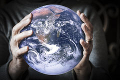 Woman`s hands holding planet Earth Stock Photo