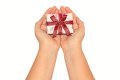 Woman's hands holding present box with red ribbon Stock Photo