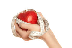 Woman's hands holding red apple Stock Images