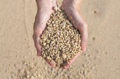 Sand heap hold in woman`s hands royalty free stock photos