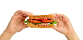 Woman's hands holding a sandwich Royalty Free Stock Image