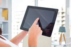 Woman's hands holding tablet computer. Composite image of woman's hands holding tablet computer with house background Stock Images