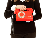 Woman's hands holding telephone Stock Photo