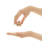 Woman's hands holding a toy house  isolated Stock Photos