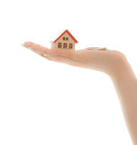 Woman's hands holding a toy house and keys Stock Photography