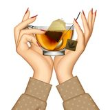 Woman`s hands holding transparent glass cup with tea and spoon i Royalty Free Stock Image
