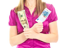 Woman's hands holding two different banknotes Royalty Free Stock Images