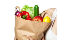 Woman's hands holding vegetables and fruits in shopping bag Royalty Free Stock Photography