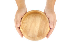 Woman's hands holding wooden bowl Stock Images
