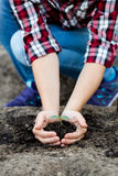 Woman's hands  holding young plant. Ecology concept Royalty Free Stock Photography