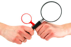 Woman's hands holds two magnifying glasses. Isolated on a white background Royalty Free Stock Image