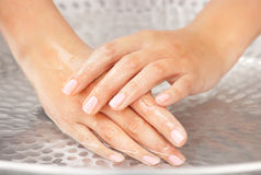 Woman's hands humidification. In the sink with water Stock Photos