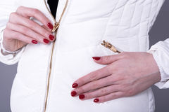 Woman`s hands and a jacket with two zips Stock Photography