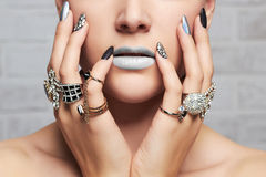 Woman`s hands with jewelry rings. Close-up beauty and fashion portrait. girl make-up and manicure Royalty Free Stock Photography