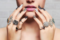 Woman`s hands with jewelry rings. Close-up beauty and fashion portrait. girl make-up and manicure Royalty Free Stock Photos