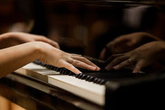 Woman's hands on the keyboard of the piano Royalty Free Stock Photos