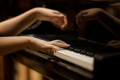 Woman's hands on the keyboard of the piano closeup Royalty Free Stock Photos