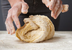 Woman's hands knead dough royalty free stock photography