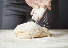 Woman's hands knead dough Stock Images