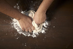 Woman's hands kneading dough Royalty Free Stock Image