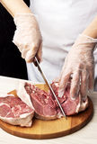 Woman's hands lamb meat. Stock Photos