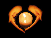 Free WOMAN S HANDS LIT BY A CANDLE Stock Images - 717214
