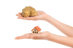 Woman's hands with little house and conch Royalty Free Stock Image