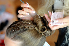Woman's hands making a hairstyle Stock Photography