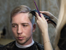 Woman's hands  making man's haircut Royalty Free Stock Images