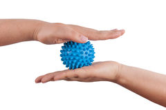 Woman's hands with massage ball Stock Images