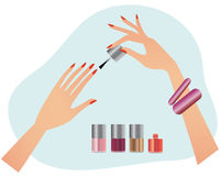 Woman´s hands with nail polish. Woman´s hands doing manicure with nail polish Royalty Free Stock Photo