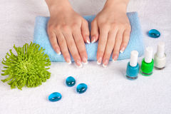 Woman's hands and nails with french manicure Stock Photo